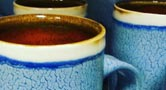 Turquoise mugs by Jonathan Dazo, a potter in Berea, Kentucky. Courtesy of Jonathan Dazo
