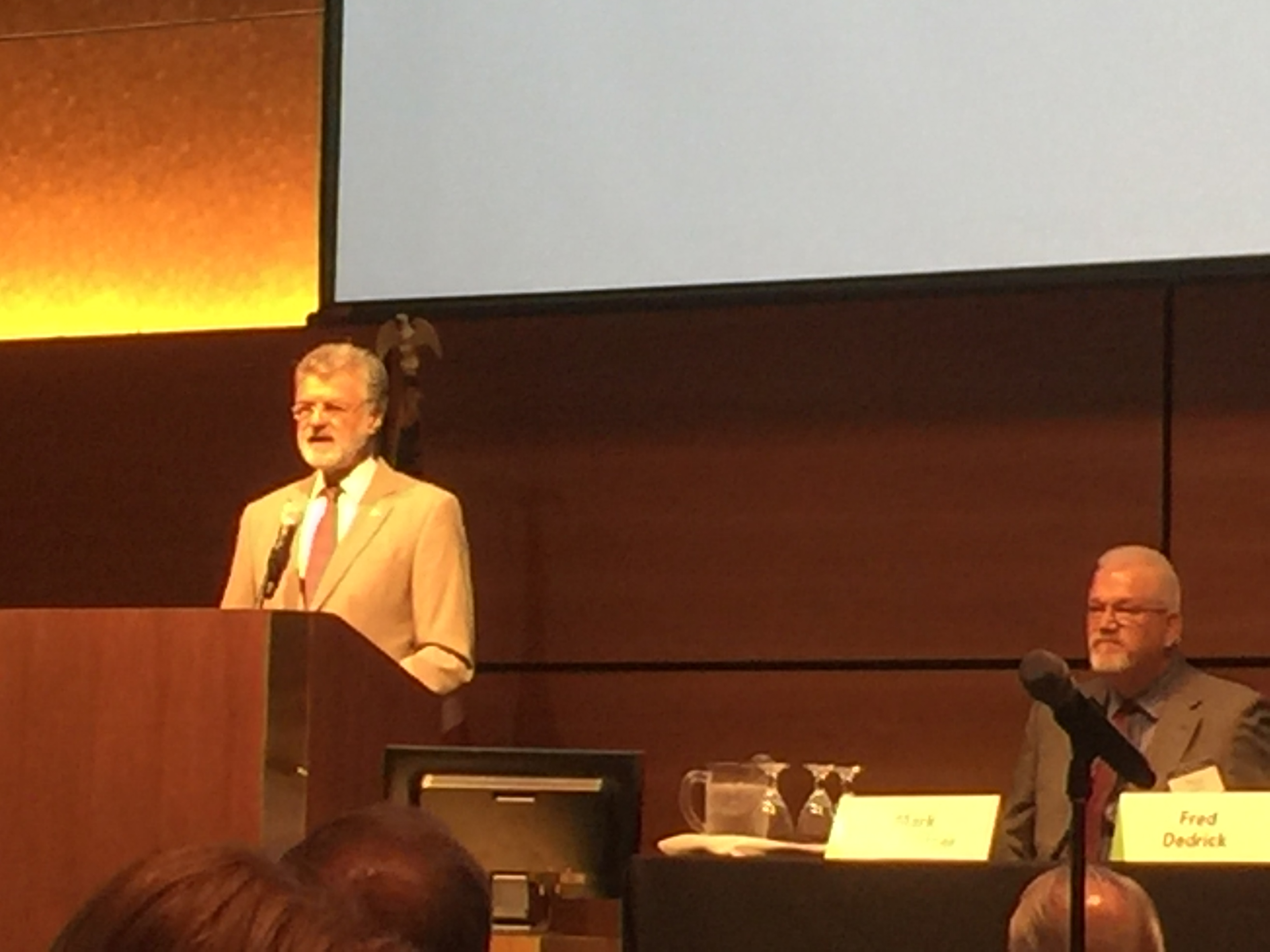 Following his introduction by host Paul Kaboth, vice president and community development officer of the Cleveland Fed (seated at right), Cleveland Mayor Frank Jackson welcomes 230-plus attendees to the Fed's 2016 Regional Workforce Development Forum on June 1.