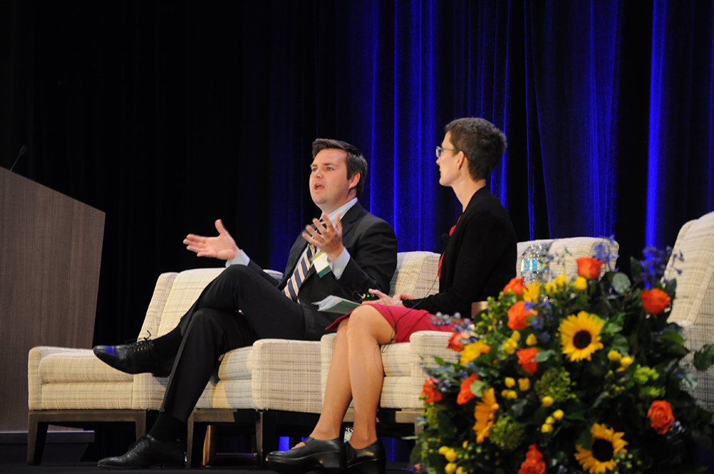 During a Q&A at the 2017 Policy Summit, keynote speaker J.D. Vance fields a question about how people who hope to escape poverty can do so without leaving an area. Mary Helen Petrus of the Cleveland Fed moderates.​