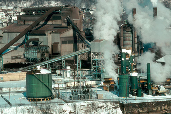 This photo depicts a steel mill in western Pennsylvania in wintertime. The steam rises steadily, day and night, all year long.